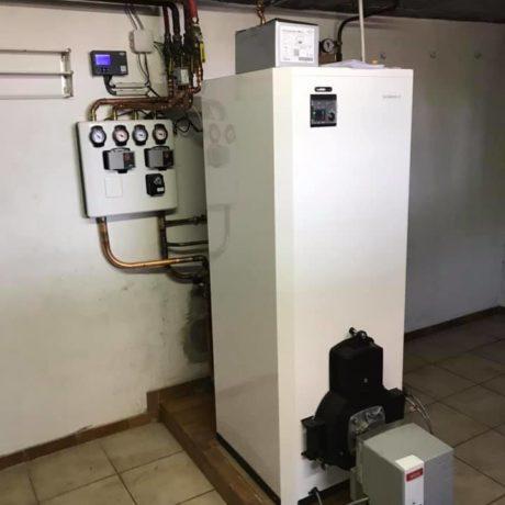 Remplacement d'une chaudière fioul avec gestion à l'aide d'une régulation d'un circuit radiateur et un circuit plancher chauffant à 68 Rosenau.